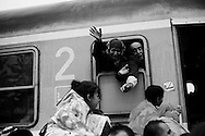 Croatia: A woman puts her arms out for her child as migrants desperately try and board a train heading for Zagreb from Tovarnik station. Alessio Romenzi