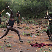 Two men fight over a dispute during an initiation ceremony of young men in order to become recognised adults within their community, about 80 Kilometres from the town of Marigat, in Baringo County, Kenya, January 20, 2016.