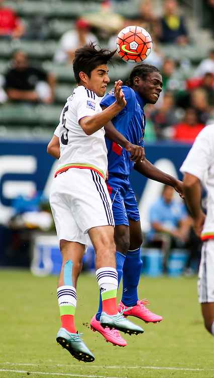 Mexico defender Rodolfo Gilbert Pizarro Thomas #5, left, and Haiti midfielder Jhon Miky Benchy Estama #7 fights for a head ball in the first half of a CONCACAF men's Olympic qualifying soccer match in Carson, Calif., Sunday, Oct. 4, 2015. (AP Photo/Ringo H.W. Chiu)