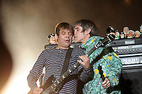 "WESTON PARK, UK:.Ian Brown and bassist Gary ""Mani"" Mounfield of The Stone Roses on stage at the V Festival on Sunday 19th August 2012..PHOTOGRAPH BY TERRY KANE / BARCROFT MEDIA LTD..UK Office, London..T: +44 845 370 2233.E: pictures@barcroftmedia.com.W: www.barcroftmedia.com..Australasian & Pacific Rim Office, Melbourne..E: info@barcroftpacific.com.T: +613 9510 3188 or +613 9510 0688.W: www.barcroftpacific.com..Indian Office, Delhi..T: +91 997 1133 889.W: www.barcroftindia.com"