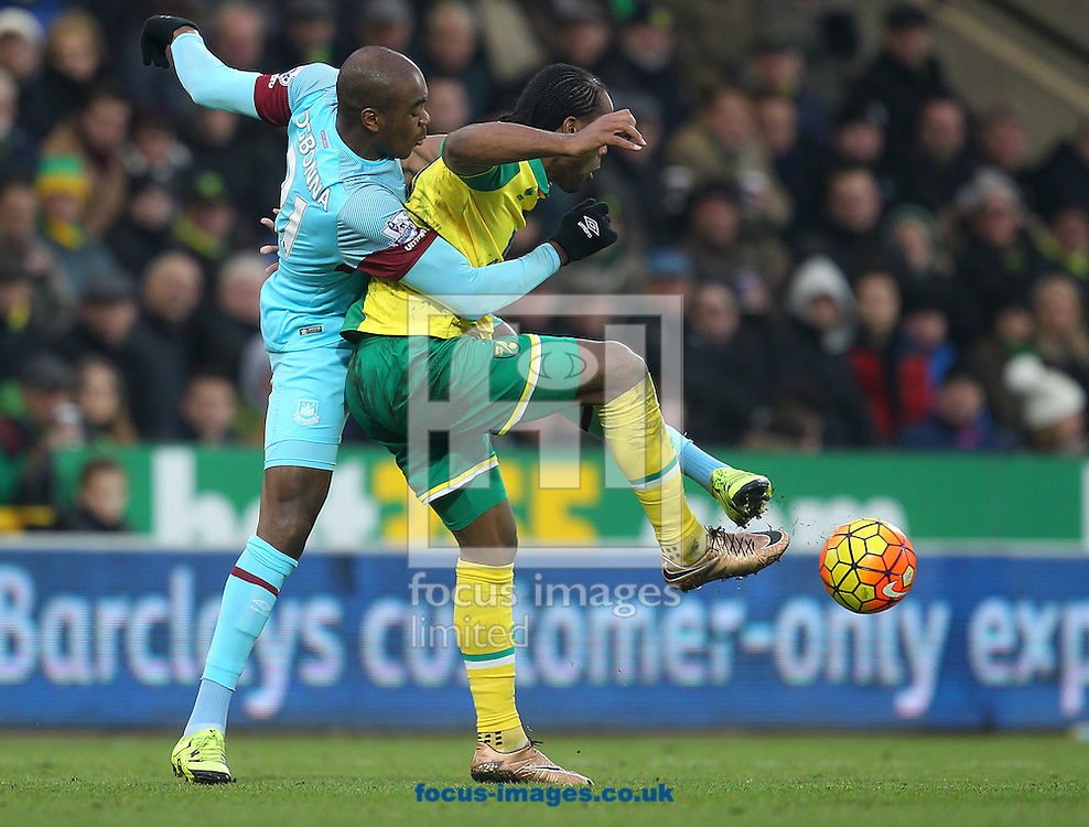 Angelo Ogbonna of West Ham and Cameron Jerome of Norwich in action during the Barclays Premier League match at Carrow Road, Norwich<br /> Picture by Paul Chesterton/Focus Images Ltd +44 7904 640267<br /> 13/02/2016
