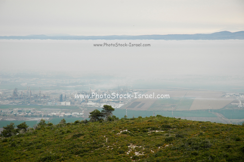 Israel, Haifa Bay Industrial area. Air Pollution the Inversion layer is visible