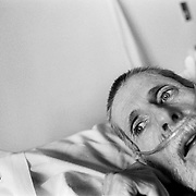 In his final days Blayne Kinart lies in his bed breathing with the aid of a respirator in a hospital?s palliative care unit.  58-year-old Blayne Kinart a former chemical worker who died from Mesothelioma, a cancer associated with asbestos exposure in Sarnia, Ontario. Residents of the area have nicknamed Sarnia ?Chemical Valley?, due to the large number of chemical plants operating in the area. Blayne passed away on July 6, 2004.