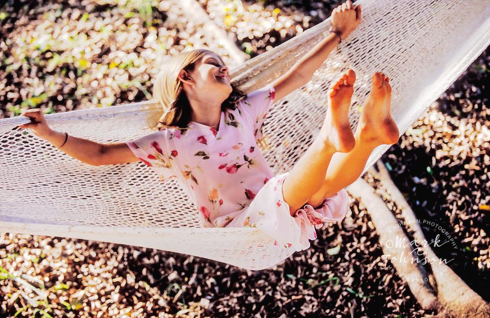 Hawaii, USA --- Girl on a Hammock