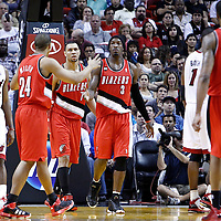 08 March 2011: Portland Trail Blazers small forward Gerald Wallace (3) celebrates with Portland Trail Blazers point guard Andre Miller (24) during the Portland Trail Blazers 105-96 victory over the Miami Heat at the AmericanAirlines Arena, Miami, Florida, USA.