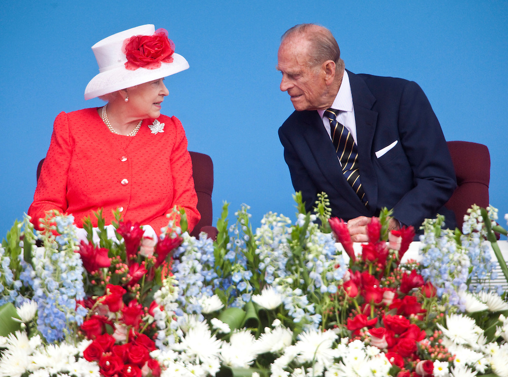 Queen Elizabeth II and Prince Philip speak during Canada Day celebrations on Parliament Hill in Ottawa, Ontario, July 1, 2010. The Queen is on a 9 day visit to Canada. <br /> AFP/GEOFF ROBINS/STR