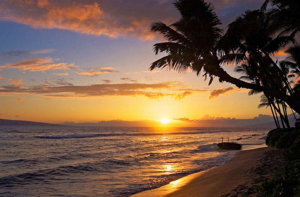 Sunset with beach and palm trees; Kaanapali Resort, Maui, Hawaii.