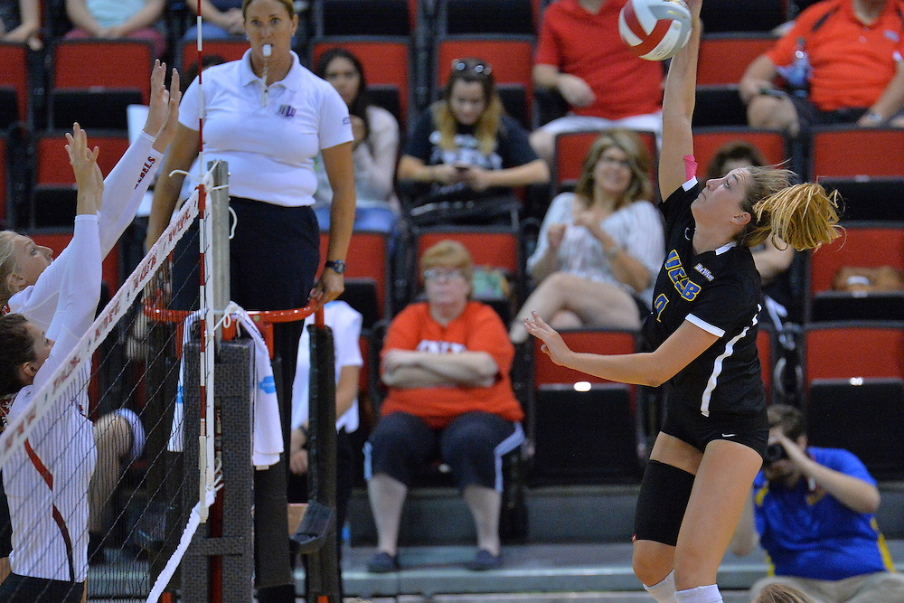 August 26, 2016; Las Vegas, Nev.; UC Santa Barbara outside hitter Lindsey Ruddins (4) takes a swing during a match between the UNLV Lady Rebels and UC Santa Barbara Gauchos. UNLV defeated UCSB 3-0.