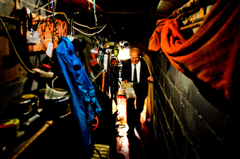 Amato Opera <br /> <br /> Tony Amato leaving the orchestra located in the basement under the stage.<br /> <br /> The Amato Opera company was founded by husband and wife Tony and Sally Amato in 1948. <br /> <br /> The opera house is located on The Bowery, in New York's East Village,  next door to where the legendary punk rock club CBGB used to be.<br /> <br /> While Tony acted as artistic director, selecting the productions, auditioning and casting, rehearsing and training the cast and conducting most of the performances, his wife Sally functioned as seamstress, light board operator, cook, box office manager, publicist, business manager, and, as Serafina Bellantoni, singer for the company until her death in 2000.<br /> <br /> Today Tony at the age of 88 is still running the company like he promised his wife he would, and the Amato Opera maintains its goals of providing opera at a reasonable price and giving promising singers stage experience in full-lenght productions.<br /> <br /> Photographer: Chris Maluszynski /MOMENT