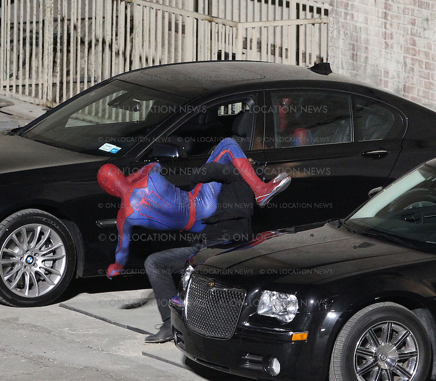 February 2nd 2011  Los Angeles, CA. Non Exclusive. The Spider Man Reboot films a scene involving a car burglar and two Spider-Man's which both appear on camera. In the scene, Andrew Garfield in character as Spider-Man is hiding in the back seat of a car that a car burglar attempts to steal. The spooked thief exits the car to escape but is taken down by a second Spider-Man as Spider-Man number one (Garfield) watches the action through the backseat window. Both Spider man's were also seen rehearsing a stunt together while covered in trench coats. Photo by Eric Ford / On Location News 818-613-3955 info@onlocationnews.com