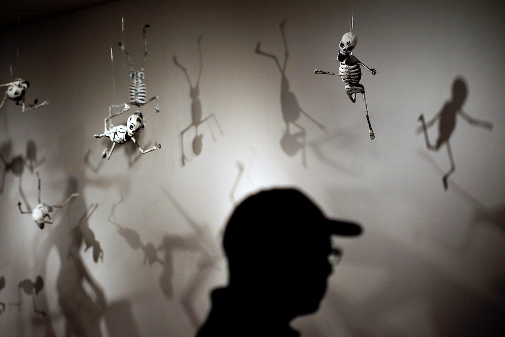 "Papier mache skeletons from ""Don Quixote Skeleton Figures"" by Pedro Linares and Sons hangs in the exhibit ""Jose Guadalupe Posada: The Birth of Mexican Modernism"" at the Dallas Museum of Art June 29, 2010.    The piece was inspired by one of Posada's works.  (Courtney Perry/The Dallas Morning News) 07072010xMETRO"
