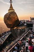 Devotees making offerings at Kyaiktiyo Pagoda (Golden rock)). Mon State, Myanmar