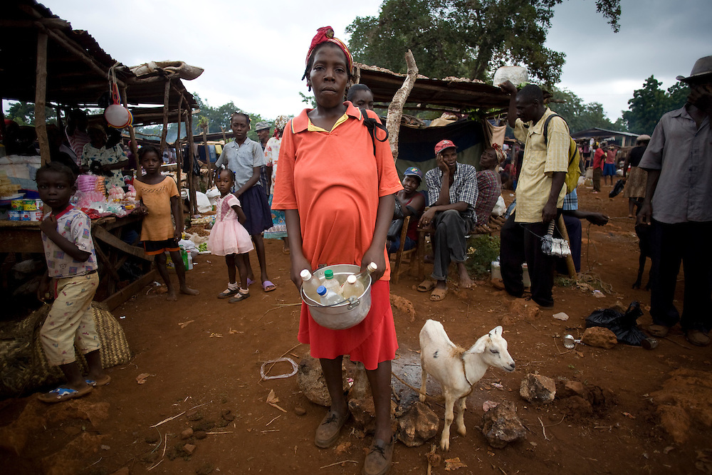 A woman Fonkoze microcredit client sells gasoline in the market.