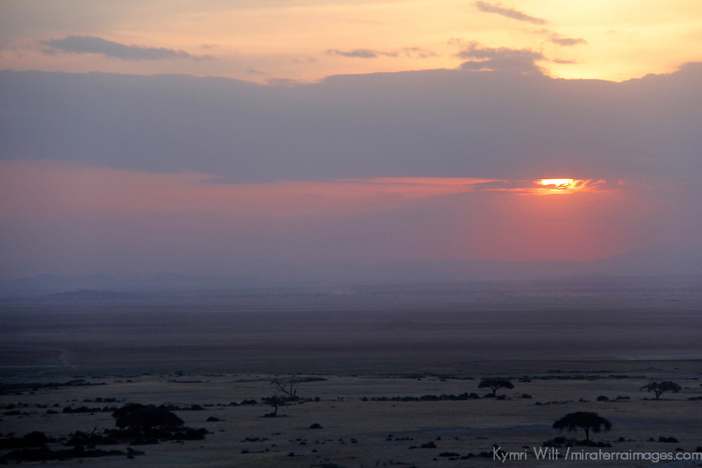 Africa, Kenya, Amboseli. Sunset over landscape of Amboseli.