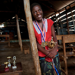 Phiona Mutesi, a 14-year-old chess prodigy, at the Agape Church inside Katwe, the largest slum in Kampala, Uganda, Dec. 9, 2010. Mutesi lives in the slums of Uganda and is just now learning to read. But her instincts have made her a player to watch in international chess. Mutesi, a naturally talented chess player is coached by Robert Katende of Sports Outreach Ministry. The chess club meets at the Agape Church.