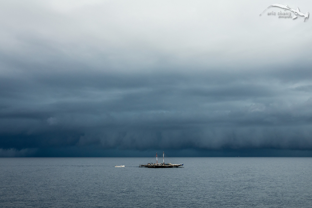 A bagan, an Indonesia fishing platform, in front of dramatic storm clouds at Kwatisore village, Cenderawasih Bay, Western Papua, Indonesia.