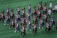 Hong Kong. . pipes and drums bands of the Gurkhas with the auxiliary police playing at Shatin jockey club horse race field.² Shatin   / Orchestre de cornemuses des Ghurkhas et de la police auxiliaire sur le champs de courses du jockey club à Shatin.