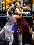 WEST LAFAYETTE, IN - MARCH 09: D.J. Byrd #21 of the Purdue Boilermakers and Elliott Eliason #55 of the Minnesota Golden Gophers battle for the ball at Mackey Arena on March 9, 2013 in West Lafayette, Indiana.  (Photo by Michael Hickey/Getty Images) *** Local Caption *** D.J. Byrd; Elliott Eliason