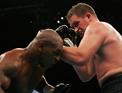 Mike Tyson (l) and Kevin McBride (r) trade punches during their 10 round heavyweight bout at the MCI Center in Washington, DC.  McBride won the fight via TKO when Tyson failed to answer the bell for the 7th round.