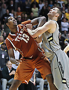 SHOT 2/26/11 5:01:24 PM - Colorado's Austin Dufault (#33) battles  Texas' Tristan Thompson (#13) under the boards for position for a rebound during their regular season Big 12 basketball game at the Coors Events Center in Boulder, Co. Colorado upset the fifth ranked Texas 91-89. (Photo by Marc Piscotty / © 2011)