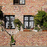 Europe, Belgium, Brugges. Bricks and windows of Brugges.