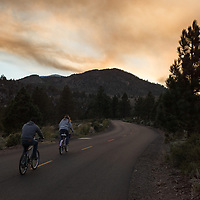 http://Duncan.co/couple-riding-bikes-and-smoke-from-wildfires