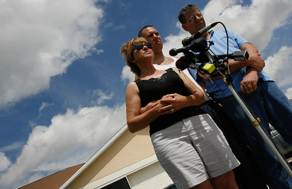 PORT CHARLOTTE, FL -- March 12, 2008 -- Becky and Kevin Hall, with their son, Justin, face the media in the driveway of her sister's home near where the body of their son Eric Hall, a former Marine, was found in Port Charlotte, Fla., on Wednesday, March 12, 2008.  The family has now turned their efforts from finding their son to raising awareness over post-traumatic stress disorder, which Hall was diagnosed with after seeing a friend die in an explosion in Iraq.  Hall went missing on Feb. 3 after having a flashback to his time in Iraq, and was found dead weeks later by Vietnam veteran volunteers in a culvert.