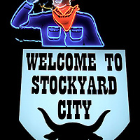 Stockyards&rsquo; Welcome Neon Sign at Night in Oklahoma City, Oklahoma<br /> In 1920, the forerunner of the Armour meatpacking company helped establish the Oklahoma Stockyards. This is now the country&rsquo;s largest cattle market. Known by the name &ldquo;Packingtown,&rdquo; it probably processes more tourists who come to watch the cattle drives, purchase western wear and eat large slabs of meat at the local restaurants. They are welcomed by this neon cowboy.