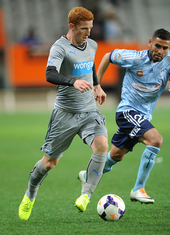 Newcastle United's Jack Colback, runs around Sydney FC's Ali Abbas in the first match of the Football United Tour at Forsyth Barr Stadium, Dunedin, New Zealand, Tuesday, July 22, 2014. Credit:SNPA / Ross Setford