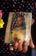 Sri Lanka. St. James Church, Kayts island, Jaffna Peninsula. Woman holds prayer book and rosary. circa 2002