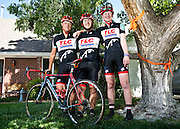 mkb080916a/metro/Marla Brose/080916<br /> Under a tree tied with multiple orange ribbons, Nathan Barkocy, 17, right, stands with Adam Brugge, center, and coach Stephen Williamson, Tuesday, August 9, 2016. Both Brugge and Williamson were riding with Barkocy when he was hit by a car and thrown from his bike during a training ride in the South Valley last January. Barkocy, who was in a coma for almost two week, has recovered and is getting ready to head back to school. He hasn't been cleared to ride a bike on his own, but he can ride a tandem bike. (Marla Brose/Albuquerque Journal)