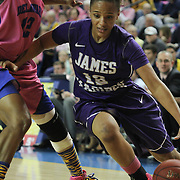 James Madison Guard Precious Hall (12) drives pass Delaware Forward Danielle Parker (12) in the second half of a regular season NCAA basketball game against Delaware Sunday, Feb 24, 2013 at the Bob Carpenter Center in Newark Delaware.