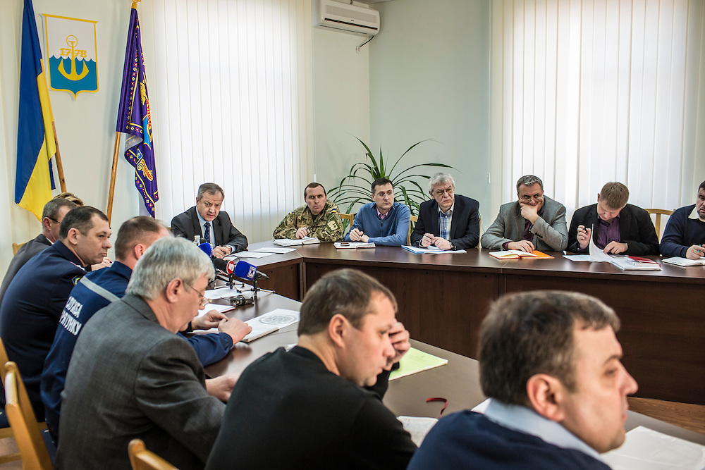 MARIUPOL, UKRAINE - FEBRUARY 4, 2015: Mariupol Mayor Yuriy Hotlubey, left, convenes a meeting to discuss emergency plans in Mariupol, Ukraine. The port city, which was hit late last month by an artillery barrage that killed at least 30 people, is preparing for possible fighting to defend against pro-Russia rebels. CREDIT: Brendan Hoffman for The New York Times