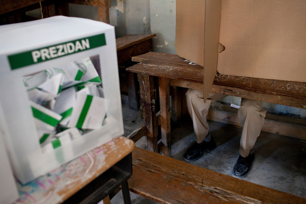 A man casts his ballot for presidential and legislative elections on November 28, 2010 in Port-au-Prince, Haiti.