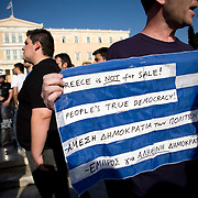Tens of thousands of people gather around Syntagma square. People are protesting against the Government's handling of the economic crisis in Athens, Greece. Image © Angelos Giotopoulos/Falcon Photo Agency