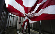 The 20 x 30-foot Stars &amp; Stripes is raised and lowered five times a week atop the Two Union Square building (weather permitting) It's one of the most prominent flags on the Seattle Skyline.<br />