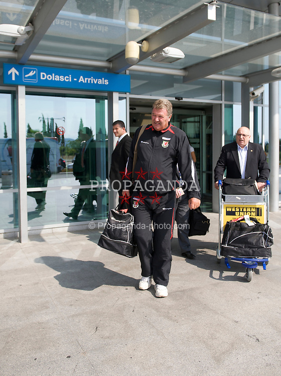 PODGORICA, MONTENEGRO - Monday, August 10, 2009: Wales' manager John Toshack MBE and FAW President Peter Rees arrive at Podgorica Airport ahead of the international friendly match against Montenegro. (Photo by David Rawcliffe/Propaganda)