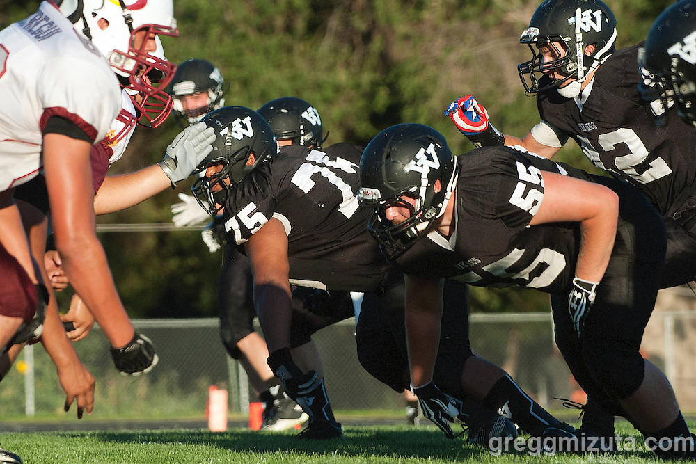 Vale defensive (L to R: Kye Yraguen, Tyson Aldred, Sage Delong) rush the passer during the season opener against Ontario on Friday August 30, 2013 at Frank Hawley Stadium in Vale, Oregon. Vale won the game 29-21.