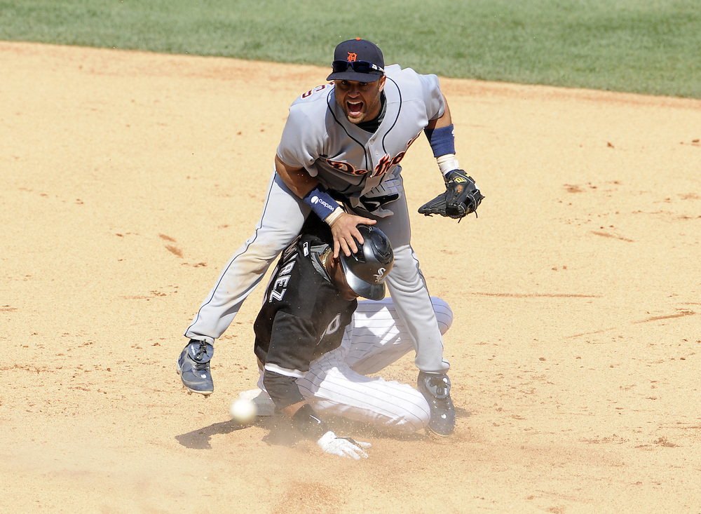 CHICAGO - JUNE 08:  Placido Polanco #14 of the Detroit Tigers turns a game ending double play over the sliding Alexei Ramirez of the Chicago White Sox in the ninth inning on June 8, 2009 at U.S. Cellular Field in Chicago, Illinois.  The Tigers defeated the White Sox 5-4.  (Photo by Ron Vesely)