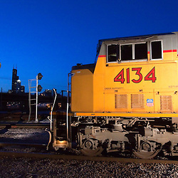 A Union Pacific locomotive rounds the curve at Canal St, on the south side of Chicago, IL, shortly after sunset on a beautiful spring evening.