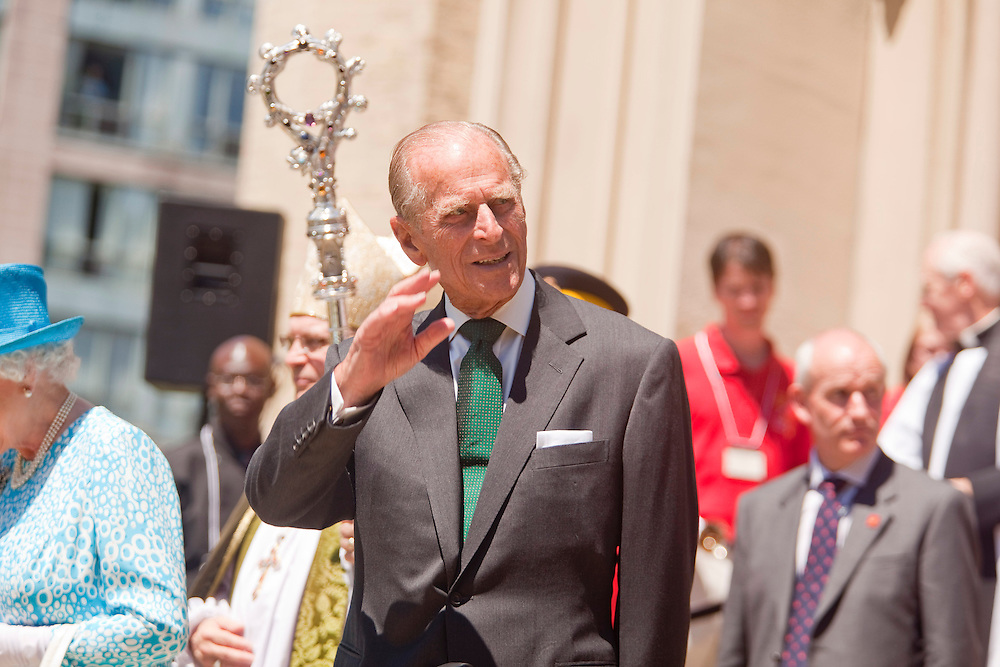 Prince Philip, The Duke of Edinburgh waves to the crowd assembled outside St. James' Cathedral in Toronto, Canada, following Sunday service July 4, 2010.<br /> AFP/GEOFF ROBINS/STR