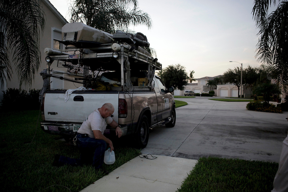 "Trapper Dave Regel rests at his truck after catching three alligators on one call. years and old injuries have worn on him. Regel walks with a hitch in his gait, likely the result of two knee surgeries and one back operation. ""I can't lift near what I used to and it's hard,"" Regel said. ""I've never considered myself Mr. Macho, but inherently men have a tendency to do that. It's hard for anybody when something takes him away from what they do. It plays with their mind."" Greg Kahn/Staff"