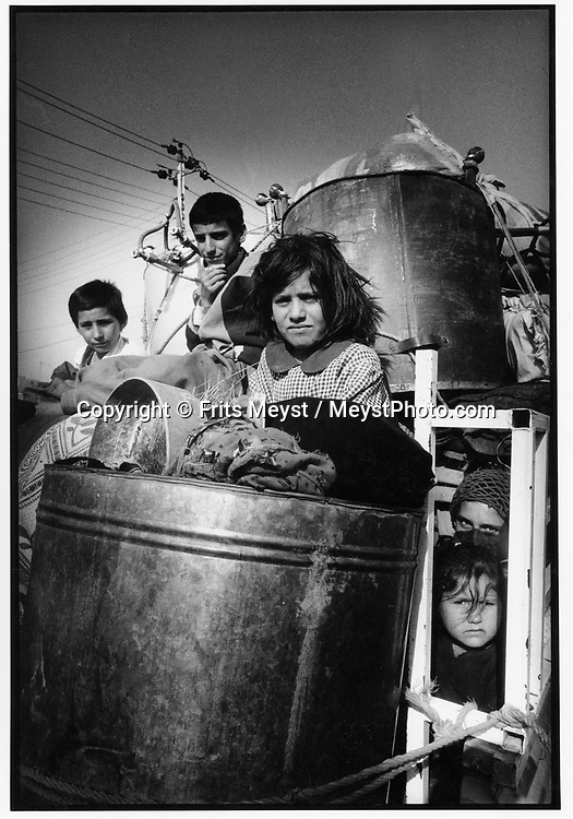 QALAR, KURDISTAN, IRAQ, 15.11.91. Kurdish refugees return from turkey to the designated UN Save Haven in Northern Iraq. They arrive in their hometown to find their homes destroyed by the Iraqi Army. ©Photo by Frits Meyst/NewsImages