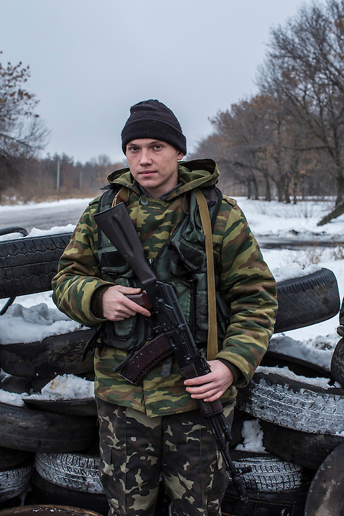 PERVOMAISK, UKRAINE - DECEMBER 8, 2014: Petr Khokhlov, a member of the First Cossack Regiment Named Platov of the Great Don Army, poses for a portrait at a checkpoint where he is stationed in Pervomaisk, Ukraine. CREDIT: Brendan Hoffman for The New York Times