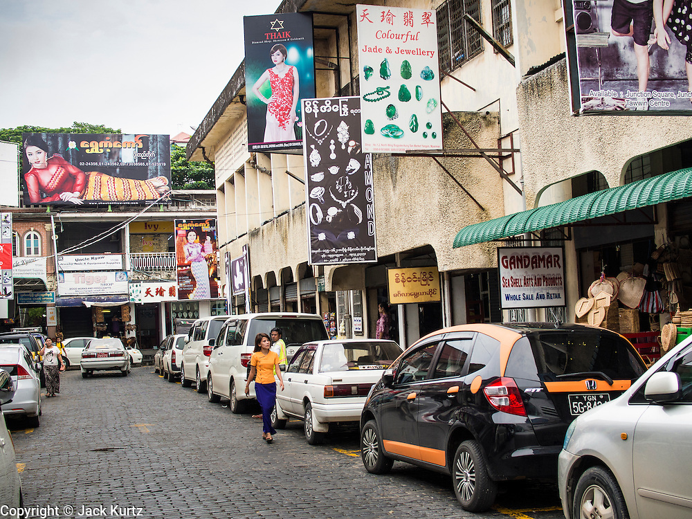10 JUNE 2014 - YANGON, MYANMAR:   A row of fashion houses in Bogyoke Aung San Market in Yangon. This is the main tourist market in Yangon.   PHOTO BY JACK KURTZ