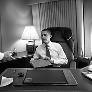 President Obama removes a classified folder before being interviewed by Newsweek Editor Jon Meacham aboard Air Force One Wednesday, May 13, 2009.  He is seated in his office on the plane...Photo by Khue Bui.