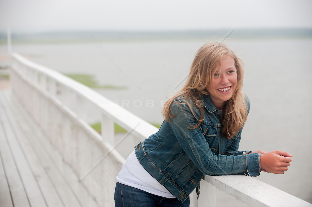 teenage girl outdoors on a deck by the bay in East Hampton, NY