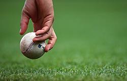 Bat boy picking up a baseball in San Francisco, 2016