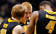 WEST LAFAYETTE, IN - JANUARY 27: Aaron White #30 of the Iowa Hawkeyes talks with teammates during a break in the game against the Purdue Boilermakers at Mackey Arena on January 27, 2013 in West Lafayette, Indiana. Purdue defeated Iowa 65-62 in overtime. (Photo by Michael Hickey/Getty Images) *** Local Caption *** Aaron White