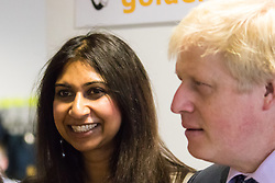 Michaela Community School, Wembley, London, June 23rd 2015. Mayor of London Boris Johnson visits the Michaela Community School, a Free School in Wembley that started taking students in September2014 after battling a certain amount of resistance from locals and unions. During the visit Head Teacher Katharine Birbalsingh took the Mayor on a tour of the school before he participated in a history lesson, prior to sitting down with pupils for brunch. PICTURED: Suella Fernandez MP (Conservative, Fareham) who was instrumental in setting up the school accompanied Mayor Boris Johnson.
